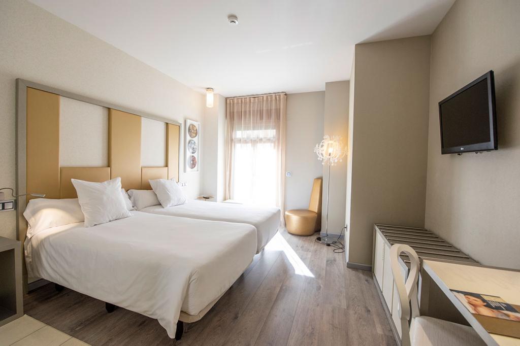 Executive doble para uso individual ( dos camas o cama matrimonial)