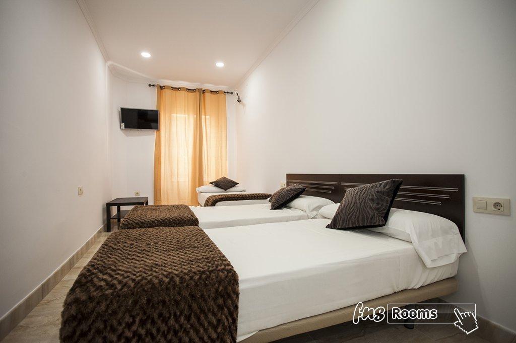Familiar 3 personas. Habitación doble con cama supletoria
