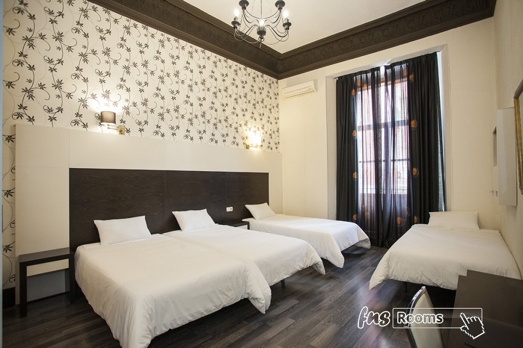 Cuádruple    - 6822-1488972413_alhambra-suites-madrid-4.jpg